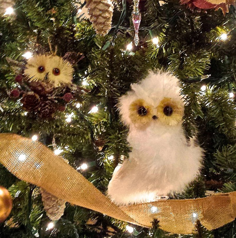 white owl ornament in christmas tree