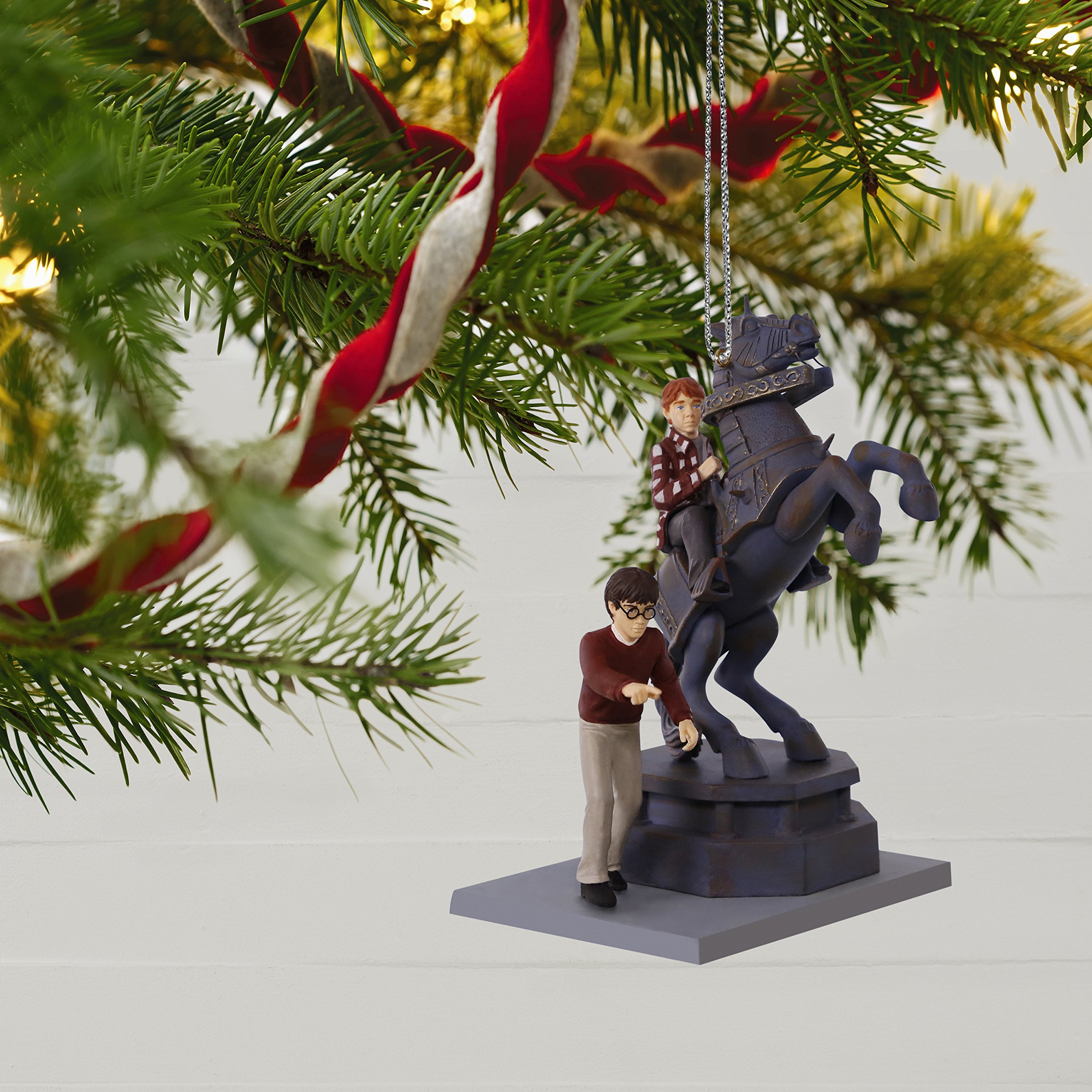 this hallmark harry potter christmas ornament depicts the exciting human chess game scene from harry potter and the sorcerers stone as ron weasley risks