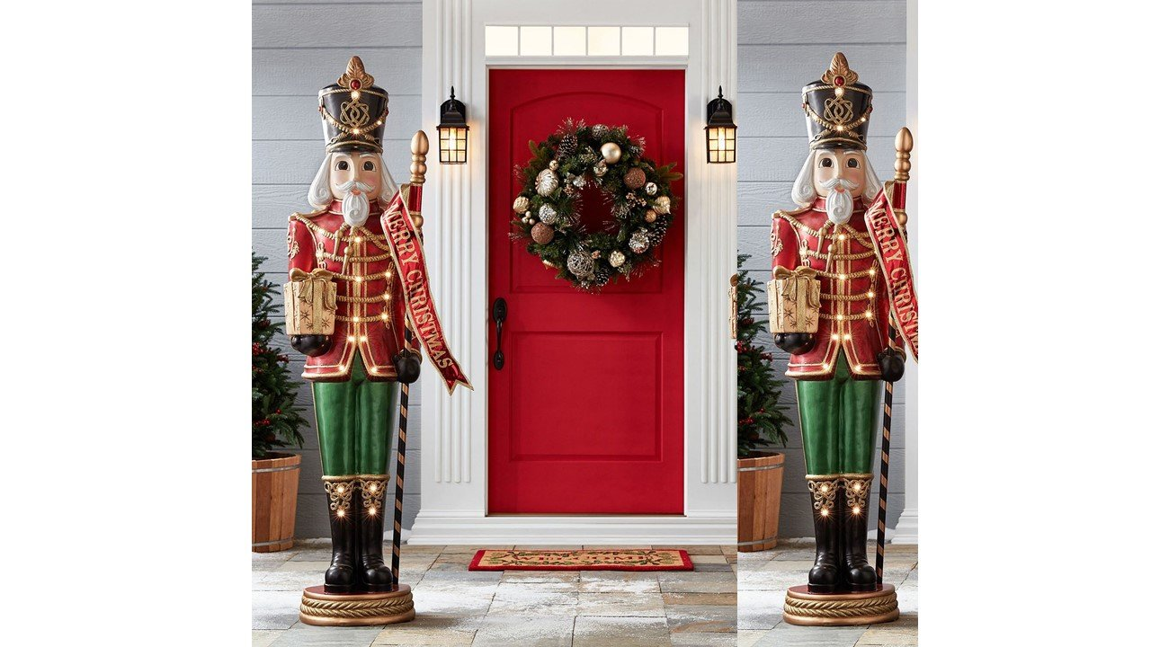 giant life size pair of 6 resin nutcracker christmas holiday toy soldiers standing tall at 6 feet and weighing approximately 80 lbs